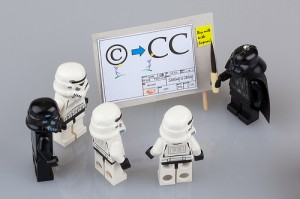 clones and Darth Vader standing around flip chart with information about Creative Commons vs. copyright